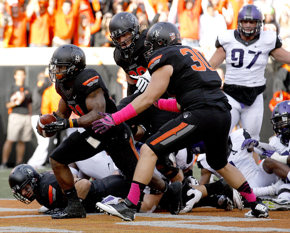 Photo - Oklahoma State's Jeremy Smith (31) scores a touchdown during a college football game between Oklahoma State University (OSU) and Texas Christian University (TCU) at Boone Pickens Stadium in Stillwater, Okla., Saturday, Oct. 27, 2012. Photo by Sarah Phipps, The Oklahoman
