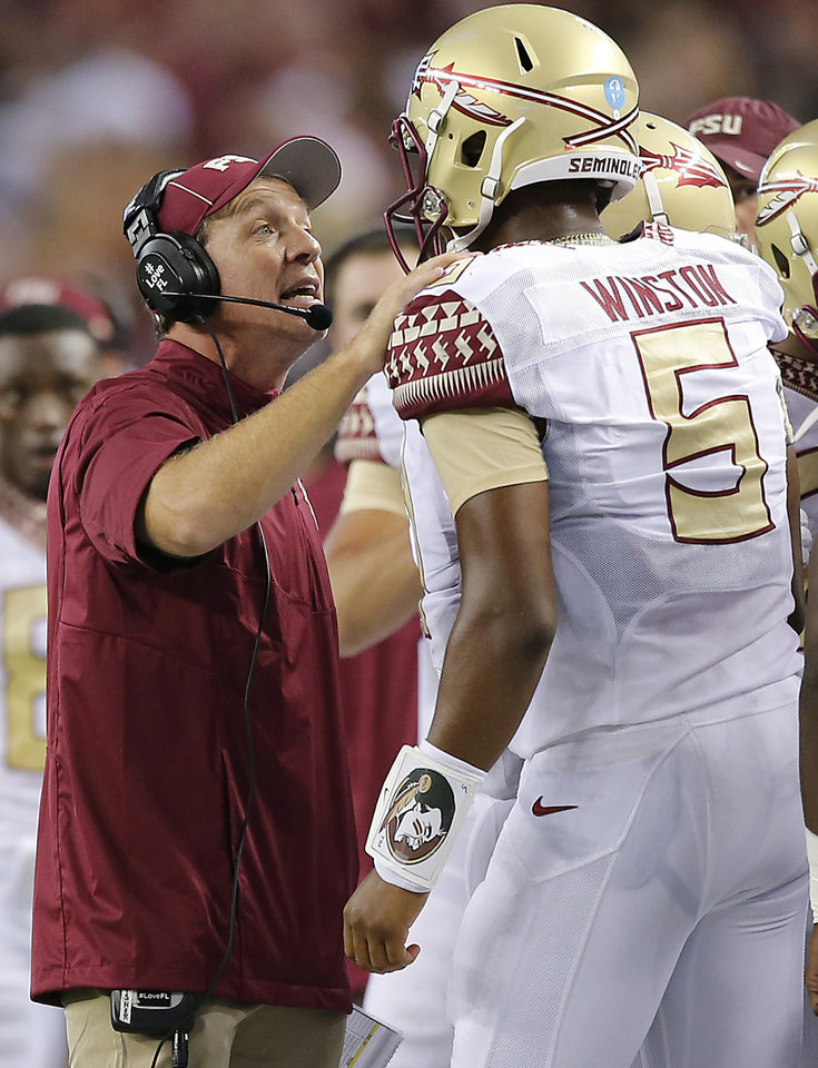 Photo - Florida State coach Jimbo Fisher talks to Florida State's Jameis Winston (5) during the college football game between Oklahoma State University (OSU) and Florida State University (FSU) at the AdvoCare Cowboys Classic at AT&T Stadium in Arlington, Texas on Saturday, Aug. 30, 2014. Photo by Chris Landsberger, The Oklahoman