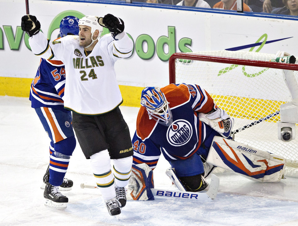 Dallas Stars' Eric Nystrom (24) celebrates Brenden Dillon's goal on Edmonton Oilers goalie Devan Dubnyk during second period NHL hockey action in Edmonton, Alberta, on Tuesday Feb. 12, 2013. (AP Photo/The Canadian Press, Jason Franson)