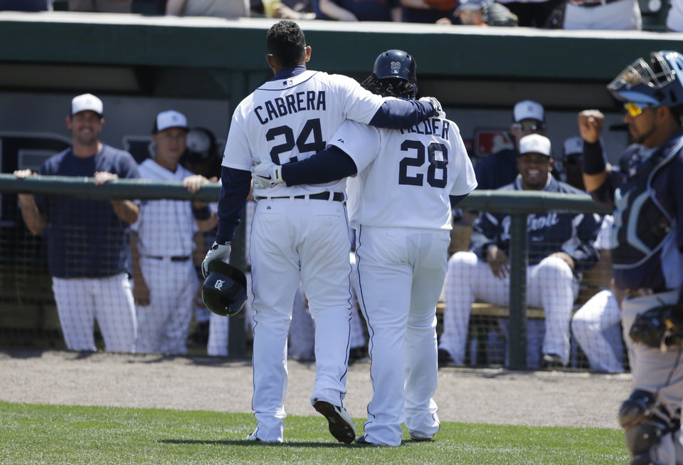 Photo - Detroit Tigers' Prince Fielder (28) and teammate Miguel Cabrera walk back to the dugout after Fielder's two-run home run during the first inning of an exhibition spring training baseball game against the Tampa Bay Rays which scored Cabrera, Friday, March 29, 2013 in Lakeland, Fla. (AP Photo/Carlos Osorio)