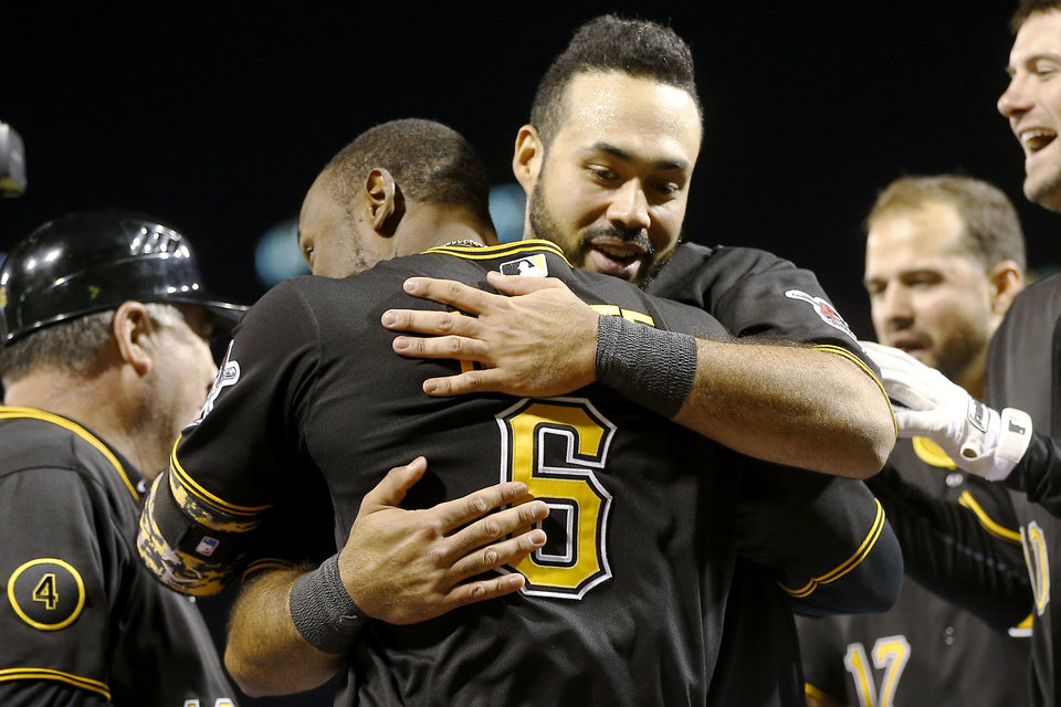 Photo - Pittsburgh Pirates' Starling Marte (6) gets a hug from Pedro Alvarez, right, after Marte hit the game-winning home run in the bottom of the ninth inning of the baseball game against the Toronto Blue Jays on Friday, May 2, 2014, in Pittsburgh. Alvarez had hit a two-run homer earlier in the inning to tie the game. The Pirates won 6-5. (AP Photo/Keith Srakocic)