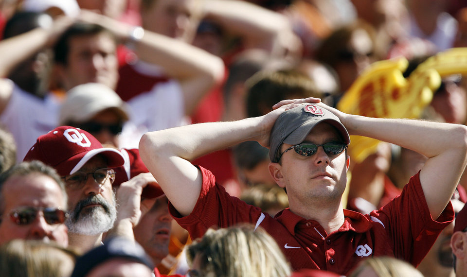 Photo - Sooner fans look on during the final seconds of the 16-13 loss to Texas during the Red River Rivalry college football game between the University of Oklahoma Sooners (OU) and the University of Texas Longhorns (UT) at the Cotton Bowl in Dallas, Texas, Saturday, Oct. 17, 2009. Photo by Chris Landsberger, The Oklahoman