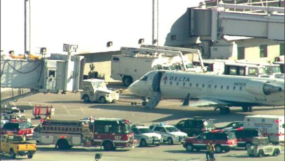 Photo -   This photo from video provided by WLS-TV in Chicago shows fire and ambulance crews on the runway at Midway Airport after reports of a medical emergency that led to the quarantine of a Delta airplane Thursday, April 26, 2012, in Chicago. (AP Photo/WLS-TV) TELEVISION OUT