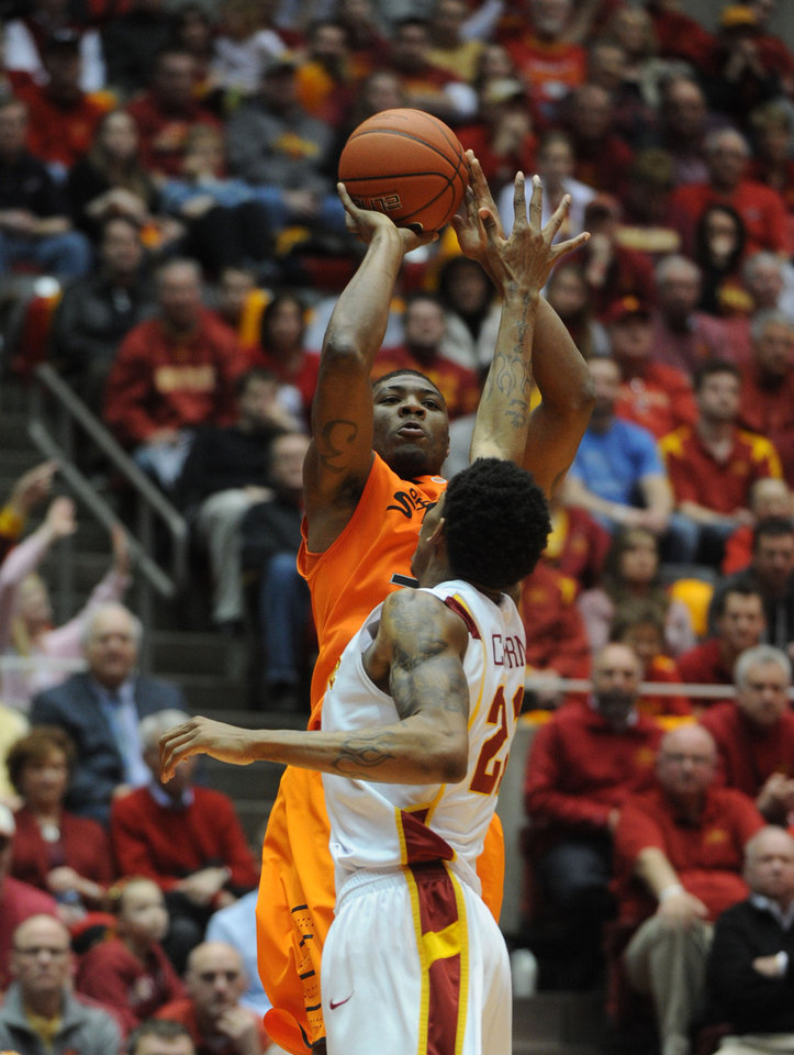 Oklahoma State's Marcus Smart takes a shot over Iowa Statre's Will Clyburn during 2nd half at Hilton Coliseum Wednesday, March 6, 2013, in Ames, Iowa. Photo by Nirmalendu Majumdar/Ames Tribune
