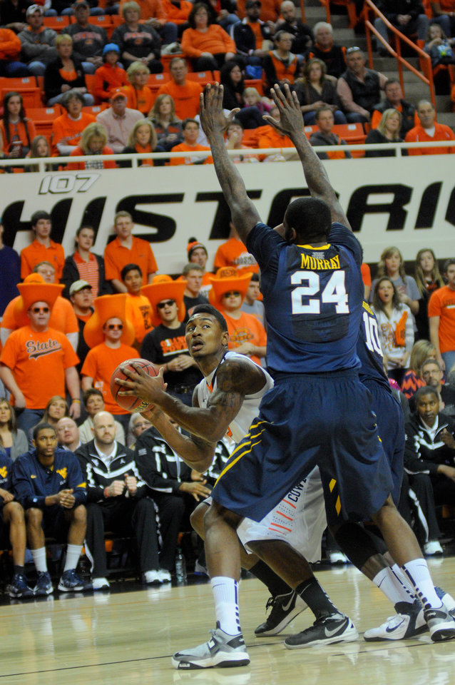 Oklahoma State forward Le\'Bryan Nash attempts to get around West Virginia defender Aaric Murray during an NCAA college basketball game in Stillwater, Okla., Saturday, Jan. 26, 2013. (AP Photo/Tulsa World, KT King) ONLINE OUT; TV OUT; TULSA OUT