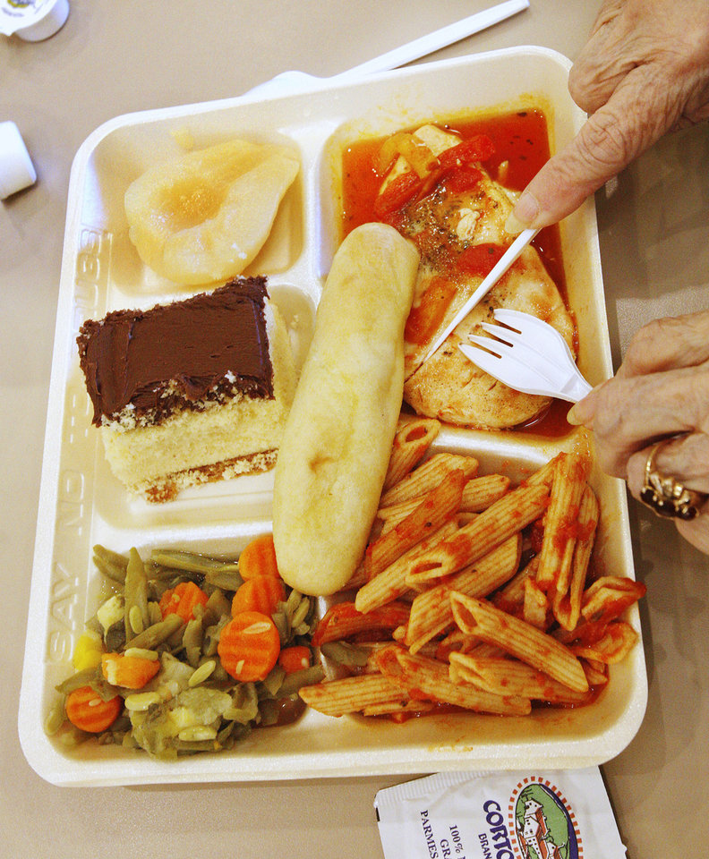 Photo - A meal is served during lunch at the Edmond Senior Center  in Mitch Park.  Photo by Paul B. Southerland, The Oklahoman  PAUL B. SOUTHERLAND - PAUL B. SOUTHERLAND
