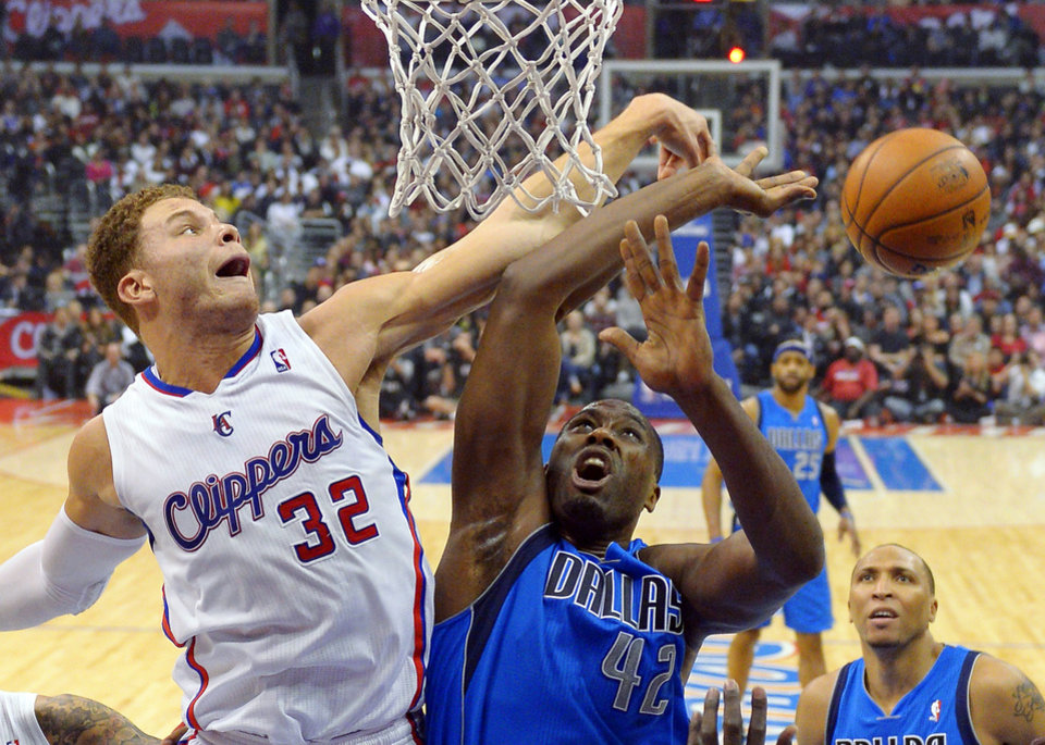 Los Angeles Clippers forward Blake Griffin (32) blocks the shot of Dallas Mavericks forward Elton Brand during the first half of their NBA basketball game, Wednesday, Jan. 9, 2013, in Los Angeles. (AP Photo/Mark J. Terrill)
