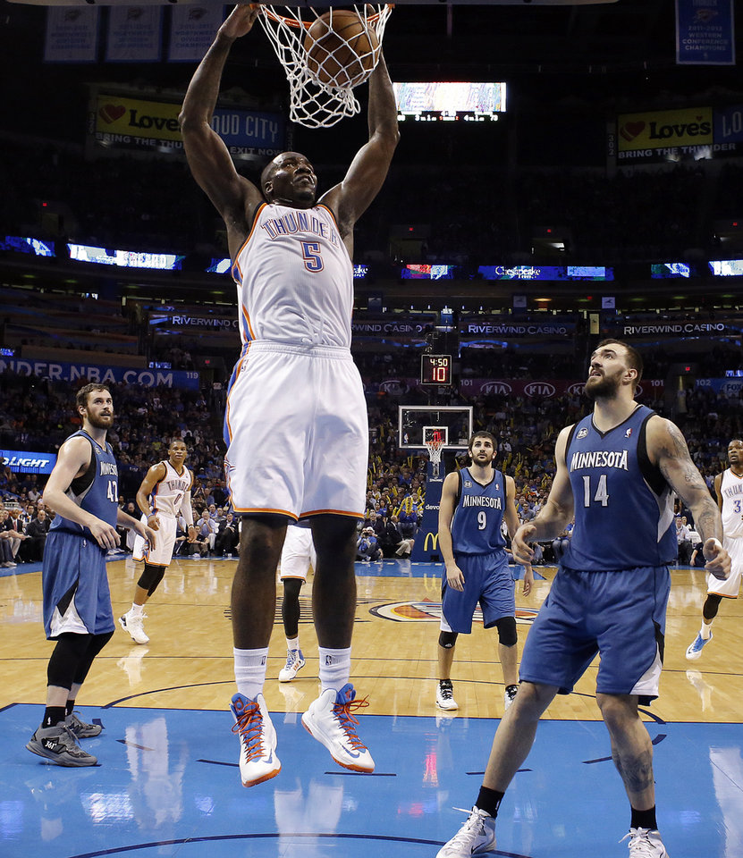 Photo - Oklahoma City's Kendrick Perkins (5) dunks the ball during the NBA game between the Oklahoma City Thunder and the Minnesota Timberwolves at the Chesapeake Energy Arena, Sunday, Dec. 1, 2013. Photo by Sarah Phipps, The Oklahoman