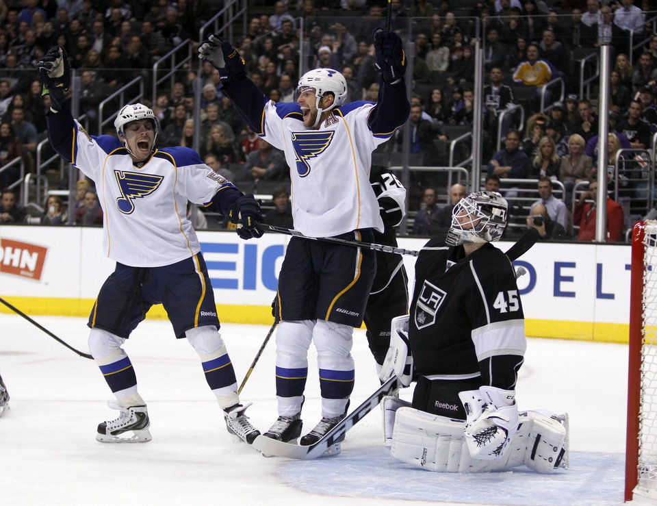 Photo - St. Louis Blues defenseman Alex Pietrangelo, center, celebrates his goal with teammate left wing David Perron, left, in front of Los Angeles Kings goalie Jonathan Bernier (45) during the first period of an NHL hockey game Tuesday, March 5, 2013, in Los Angeles.  (AP Photo/Alex Gallardo)