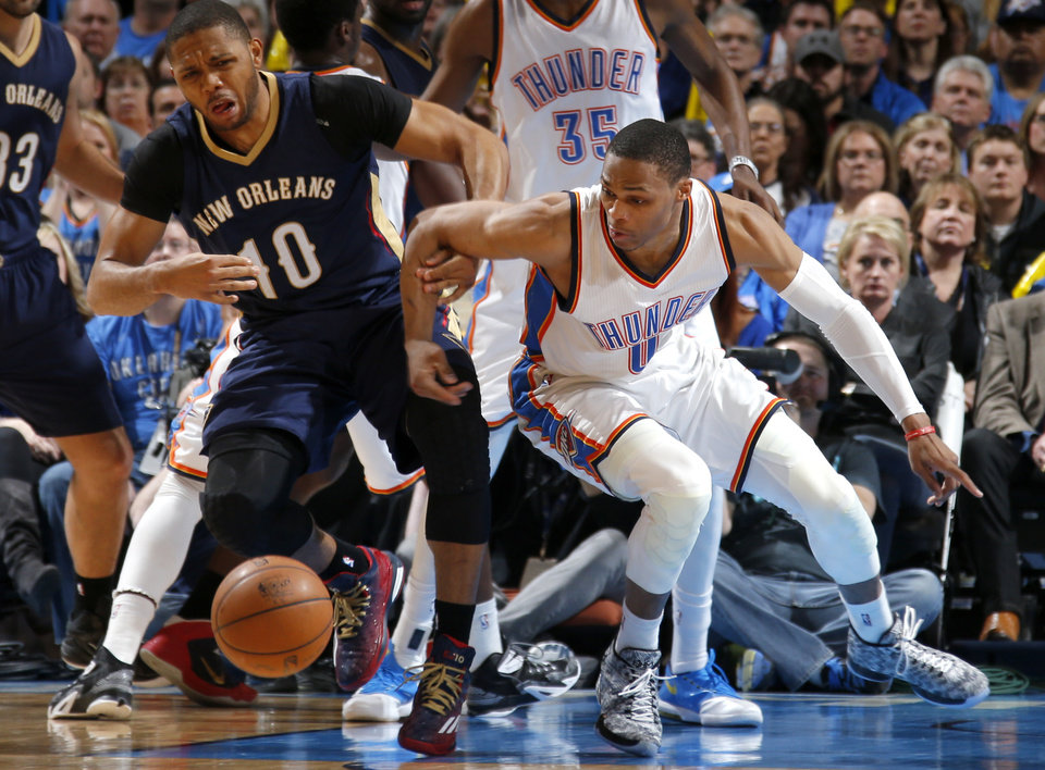 Photo - Oklahoma City's Russell Westbrook (0) steals the ball from New Orleans' Eric Gordon (10) during an NBA game between the Oklahoma City Thunder and the New Orleans Pelicans at Chesapeake Energy Arena on Friday, Feb. 6, 2015. Photo by Bryan Terry, The Oklahoman