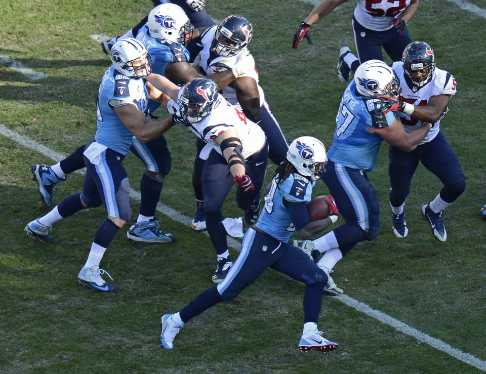 Tennessee Titans running back Chris Johnson (28) runs eleven yards for a touchdown against the Houston Texans in the third quarter of an NFL football game on Sunday, Dec. 29, 2013, in Nashville, Tenn. (AP Photo/Mark Zaleski)