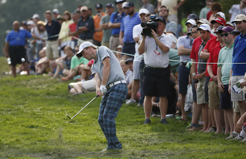 Photo - Russell Henley hits out of the rough on the 18th hole during the third round of the Deutsche Bank Championship golf tournament in Norton, Mass., Sunday, Aug. 31, 2014. (AP Photo/Michael Dwyer)