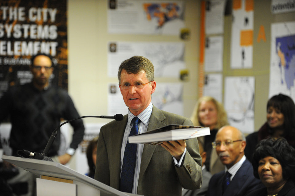 Photo - Rip Rapson, President and CEO, The Kresge Foundation, holds  a book titled