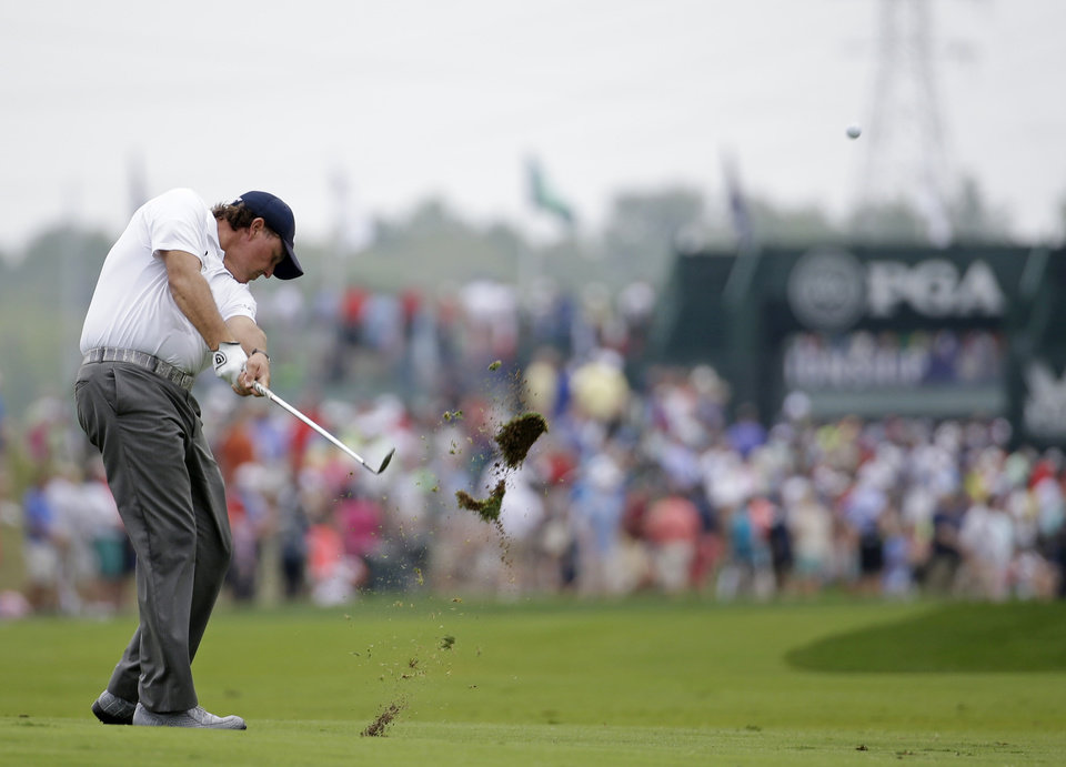 Photo - Phil Mickelson hits from the fairway on the first hole during the third round of the PGA Championship golf tournament at Valhalla Golf Club on Saturday, Aug. 9, 2014, in Louisville, Ky. (AP Photo/Jeff Roberson)