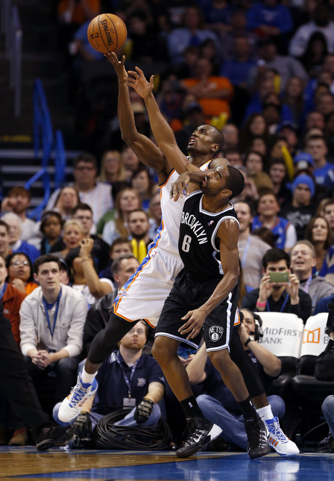 Photo - Thunder's Serge Ibaka and Brooklyn's Alan Anderson (6) battle for a rebound in the second half of an NBA basketball game where the Oklahoma City Thunder were defeated 95-93 by the Brooklyn Nets at the Chesapeake Energy Arena in Oklahoma City, on Thursday, Jan. 2, 2014. Photo by Steve Sisney, The Oklahoman