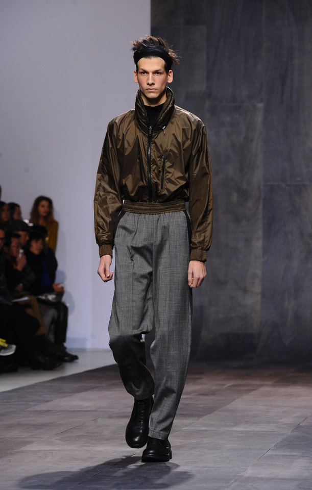 Photo - A model wears a creation by fashion designer Damir Doma as part of his fall-winter 2013/2014 men's fashion collection, in Paris, Saturday, Jan. 19, 2013. (AP Photo/Zacharie Scheurer)