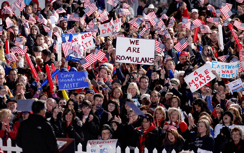 Photo -   Supporters cheer, wave American flags and signs as Republican presidential candidate, former Massachusetts Gov. Mitt Romney, lower left, speaks during a campaign event at The Square at Union Centre, Friday, Nov. 2, 2012, in West Chester, Ohio. (AP Photo/David Goldman)