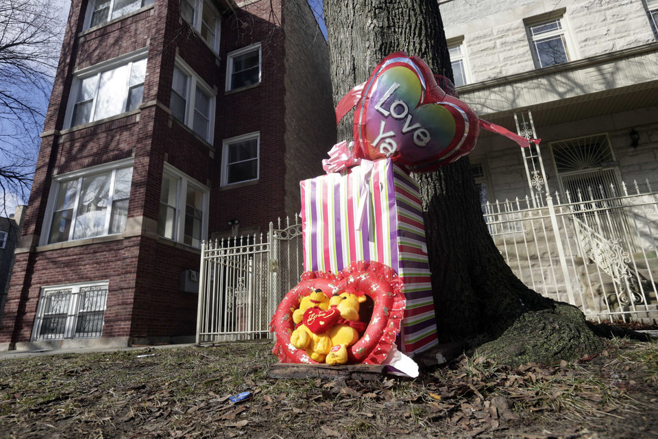 FILE - In this March 12, 2013 file photo, a makeshift memorial is seen in Chicago at the site where 6-month-old girl Jonylah Watkins, and her father, a known gang member, were shot Monday, March 11. Chicago Police Superintendent Gary McCarthy said Monday, March 18, 2013, that Jonylah Watkins was sitting in Jonathon Watkins' lap in the driver's seat of a minivan when the shooter approached the vehicle and fired. That's a change from previous reports that Watkins was changing the baby\'s diaper at the time. McCarthy also says the baby was shot once, not several times as previously reported. (AP Photo/M. Spencer Green, File)