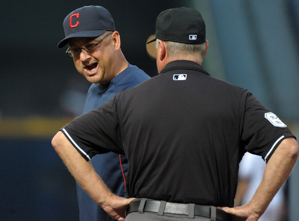 Photo - Cleveland Indians manager Terry Francona, left, exchanges parting words with umpire Jim Joyce after a close first base play involving runner Michael Bourn against the Atlanta Braves during the third inning of a baseball game at Turner Field, Tuesday, Aug. 27, 2013, in Atlanta. (AP Photo/David Tulis)