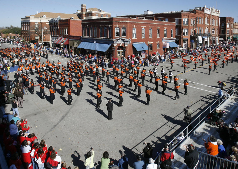 Photo - OSU: The Oklahoma State University marching band passes by the Oklahoma Publishing Museum during the Centennial Day Parade in Guthrie, OK, Thursday, Nov. 16, 2007. By Paul Hellstern / The Oklahoman