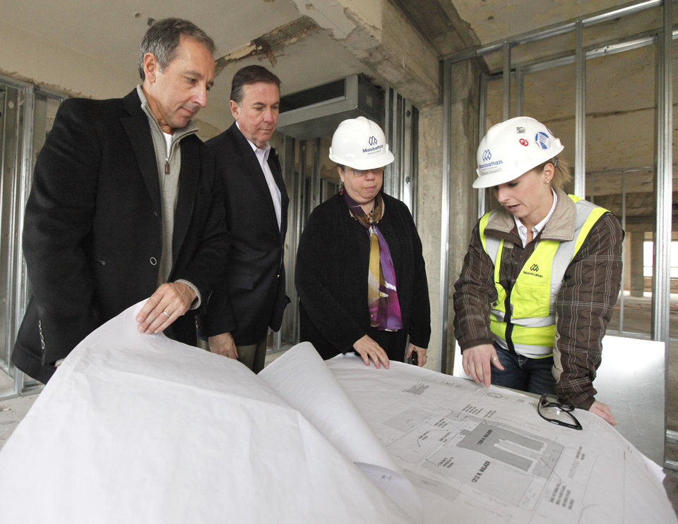 Paul Coury, left, Jeff Erwin, Catherine Montgomery, and Andrea Gossard discuss renovations underway at the Osler Building at 1200 N. Walker in Oklahoma City, OK, Thursday, March 21, 2013,  By Paul Hellstern, The Oklahoman