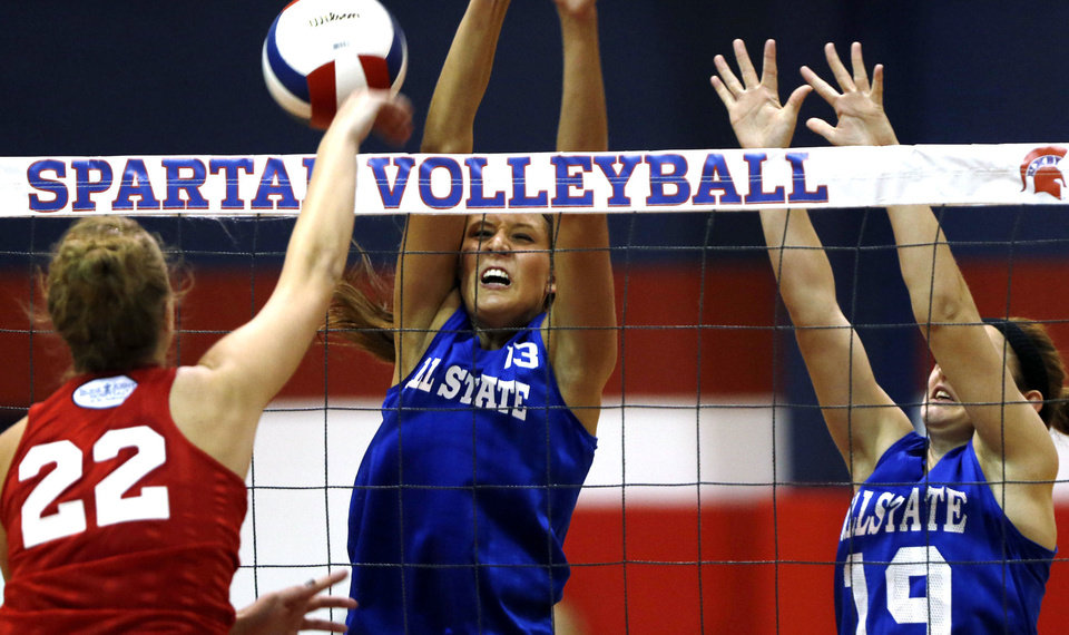 Photo - Small East's Jaime Rahilly (13) of Cascia Hall and Haylie Kinzey (19) of Catoosa defend a hit by the West's Courtney Bowie (22) of Bethany during the all-state volleyball play at Whitey Ford Gymnasium at Bixby High School, on Tuesday, July 30, 2013. CORY YOUNG/Tulsa World
