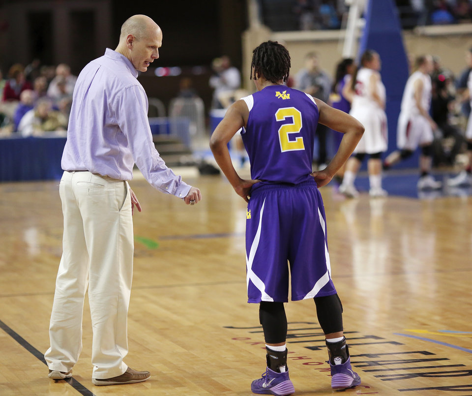 Photo - Anadarko head coach Jeff Zinn talks to player Tandra King during the Class 4A State championship game between Ft. Gibson and Anadarko at Jim Norick Arena at State Fair Park  on Saturday, Mar. 15, 2014. Ft. Gibson came from behind much of the second half to win 50-47.  Photo by Jim Beckel, The Oklahoman