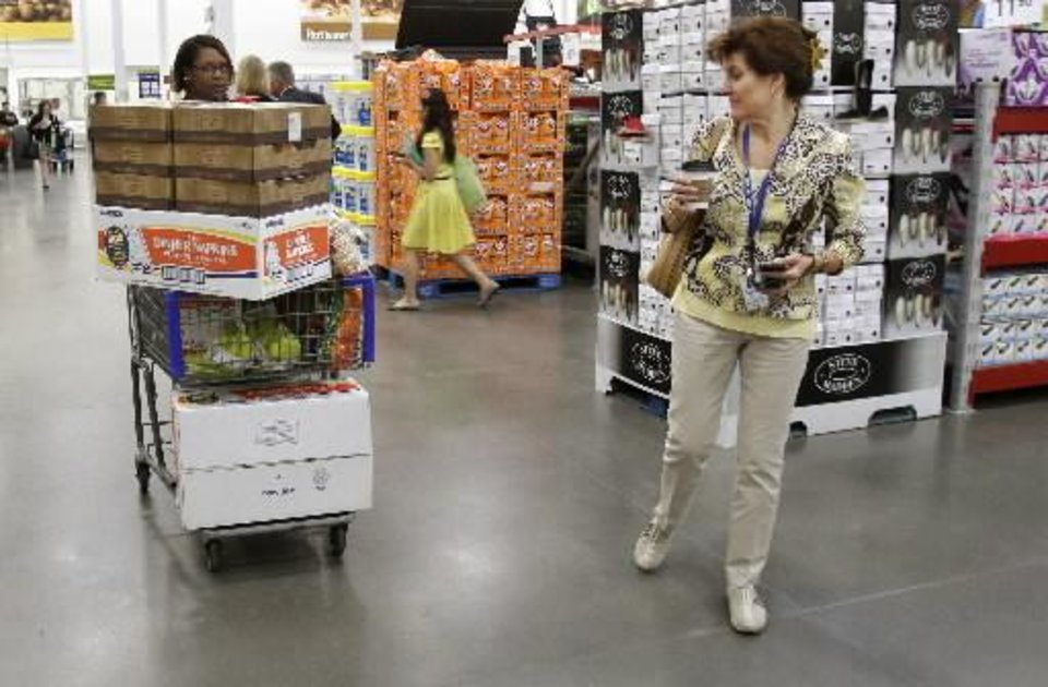 In this June 2, 2011 photo, shoppers Leslie Corridon, left, and Leslie Christon walks the aisles at a Sam\'s Club store in Rogers, Ark. (AP Photo/Danny Johnston)