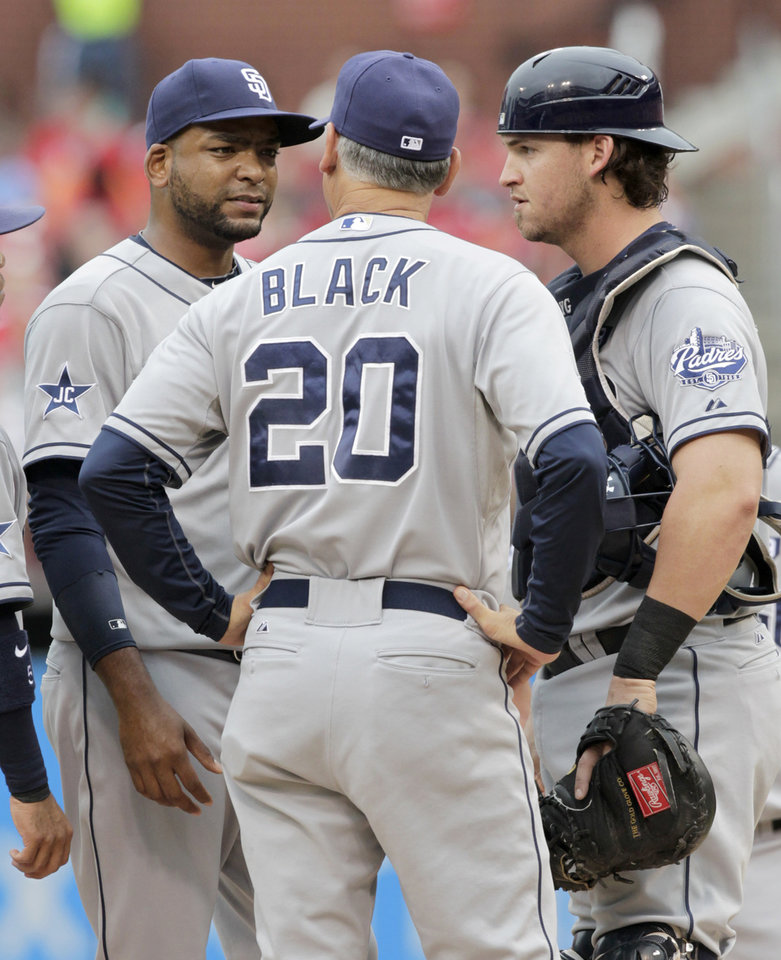 Photo - San Diego Padres manager Bud Black (20) talks with starting pitcher Odrisamer Despaigne and catcher Yasmani Grandal after the St. Louis Cardinals score four runs in the first inning of a baseball game, Sunday, Aug. 17, 2014, in St. Louis. (AP Photo/Tom Gannam)