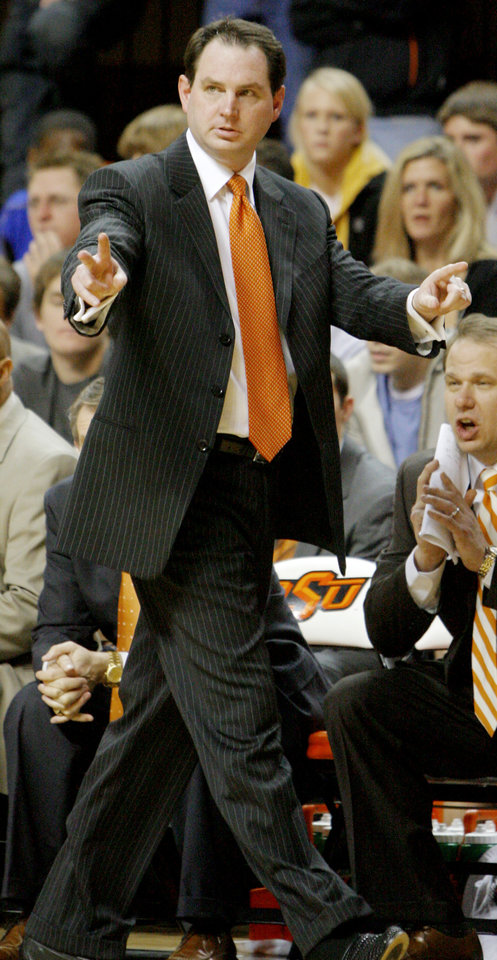 Photo - OSU head coach Sean Sutton calls a play in the second half during the college basketball game between Oklahoma State University and the University of Texas at Gallagher-Iba Arena in Stillwater, Okla., Monday, January 21, 2008. BY MATT STRASEN, THE OKLAHOMAN ORG XMIT: KOD