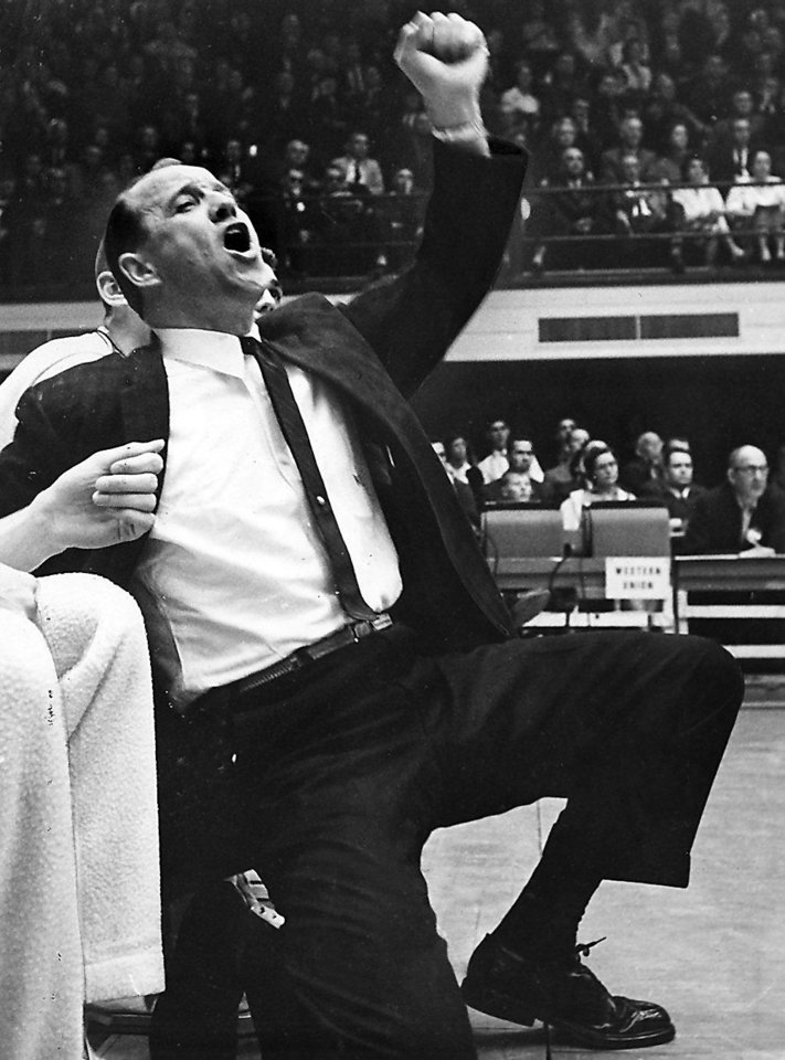New Sooner basketball coach Bob Stevens was born into show business and these courtside pictures from South Carolina days show theatrics are still very much in his blood.  Stevens coached the Sooners from 1962-67. PHOTO BY CHARLES H. COOPER/HERALD-SUN PAPER/DURHAM, NORTH CAROLINA      Published in The Oklahoma City Times 04/17/1962 and in The Daily Oklahoman 02/03/1987.