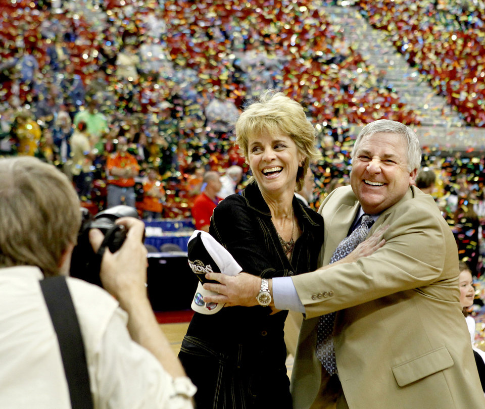 Photo - Baylor coach KimKim Mulkey celebrates with Johnny Derrick after winning the championship game of the Big 12 Women's Basketball Championship between Baylor and Texas A&M at the Cox center in Oklahoma City, Sunday, March 15, 2009. PHOTO BY BRYAN TERRY, THE OKLAHOMAN