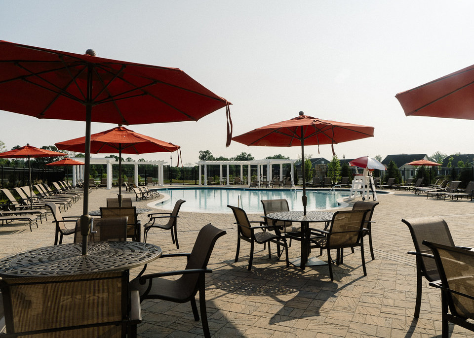 Photo -  The outdoor pool and lounge area at Two Rivers in Odenton, Maryland. William Gerald, a vice president at the company that developed Two Rivers, says clubhouses for exercising and socializing are essential for senior-centered developments. [PHOTO BY JUSTIN T. GELLERSON, FOR THE WASHINGTON POST]