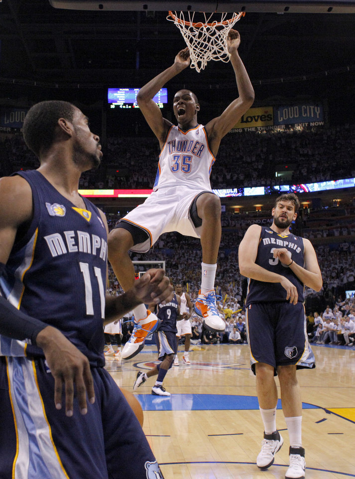 Photo - Oklahoma City's Kevin Durant (35) reacts after a dunk between Mike Conley (11) and Marc Gasol (33) of Memphis during game five of the Western Conference semifinals between the Memphis Grizzlies and the Oklahoma City Thunder in the NBA basketball playoffs at Oklahoma City Arena in Oklahoma City, Wednesday, May 11, 2011. Photo by Bryan Terry, The Oklahoman