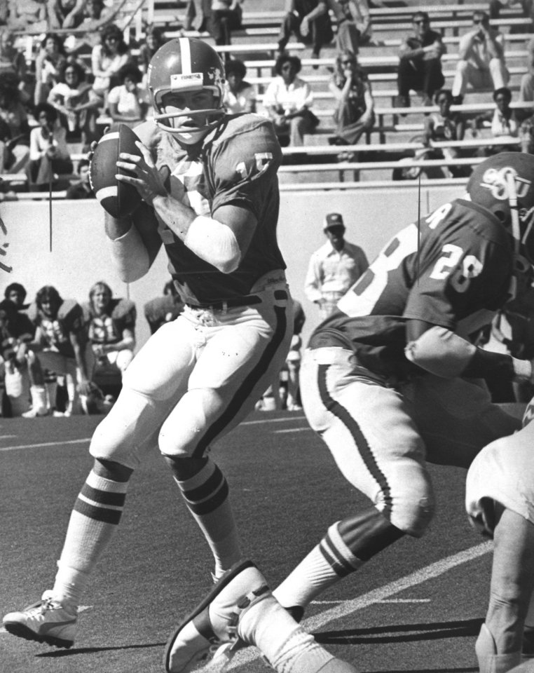 Photo - FOOTBALL: 1976 - quarterback Charlie Weatherbie drops back to pass during the Oklahoma State scrimmage