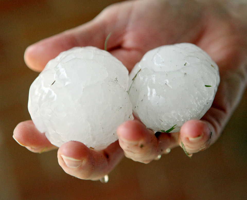 A resident of the Village holds large hailstones outside her home during a storm in the Oklahoma City metro area on Sunday, May 13, 2010. By John Clanton, The Oklahoman