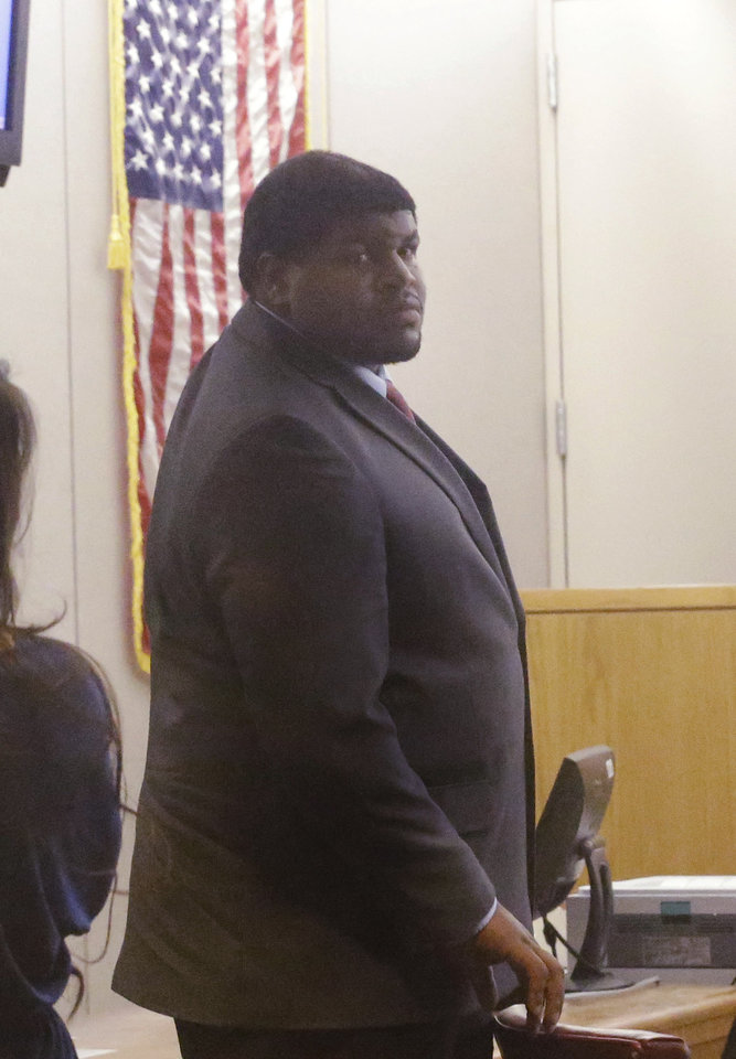 Photo - Former Dallas Cowboy Josh Brent stands in court during his trial for intoxication manslaughter, Thursday, Jan. 16, 2014, in Dallas. Brent is accused of driving drunk at the time of a December 2012 crash that killed Cowboys practice squad player Jerry Brown. (AP Photo/LM Otero)