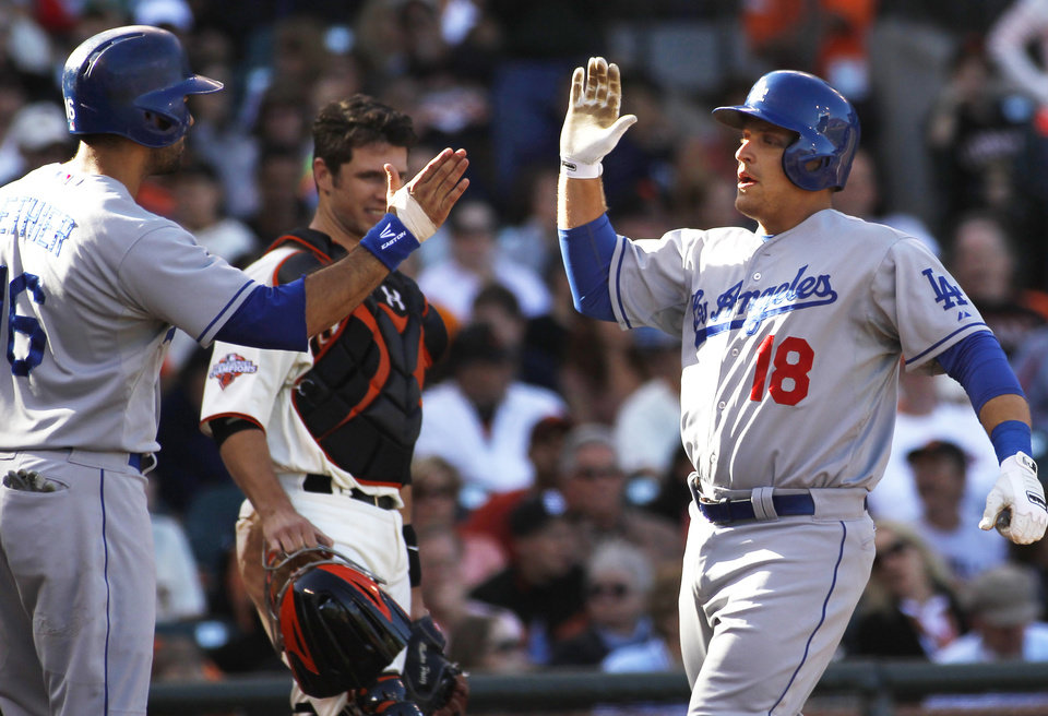 Photo - Los Angeles Dodgers' Tim Federowicz (18) is greeted at the plate by teammate Andre Ethier after hitting a two-run home run against the San Francisco Giants during the fifth inning of a baseball game in San Francisco, Saturday, July 6, 2013. Giants catcher Buster Posey, center, looks on. (AP Photo/George Nikitin)
