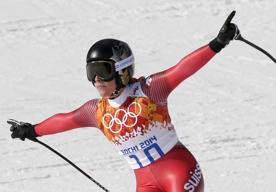 Photo - Switzerland's Lara Gut finishes in the downhill portion of the women's supercombined at the Sochi 2014 Winter Olympics, Monday, Feb. 10, 2014, in Krasnaya Polyana, Russia. (AP Photo/Gero Breloer)