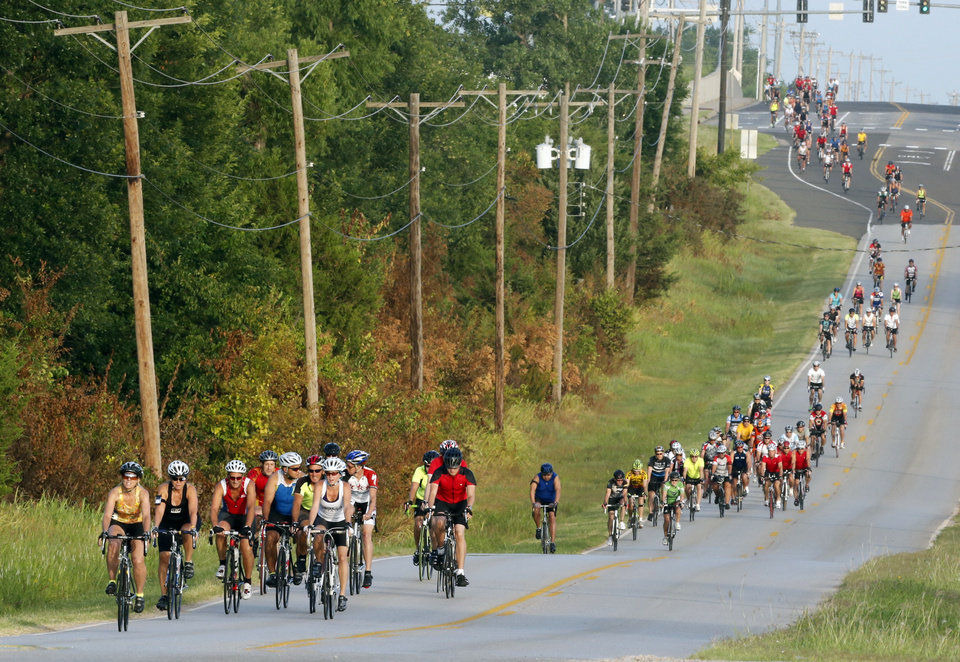 Photo -  Riders travel east on Robinson Street during the annual Norman Conquest bike ride. PHOTO BY STEVE SISNEY, THE OKLAHOMAN   STEVE SISNEY