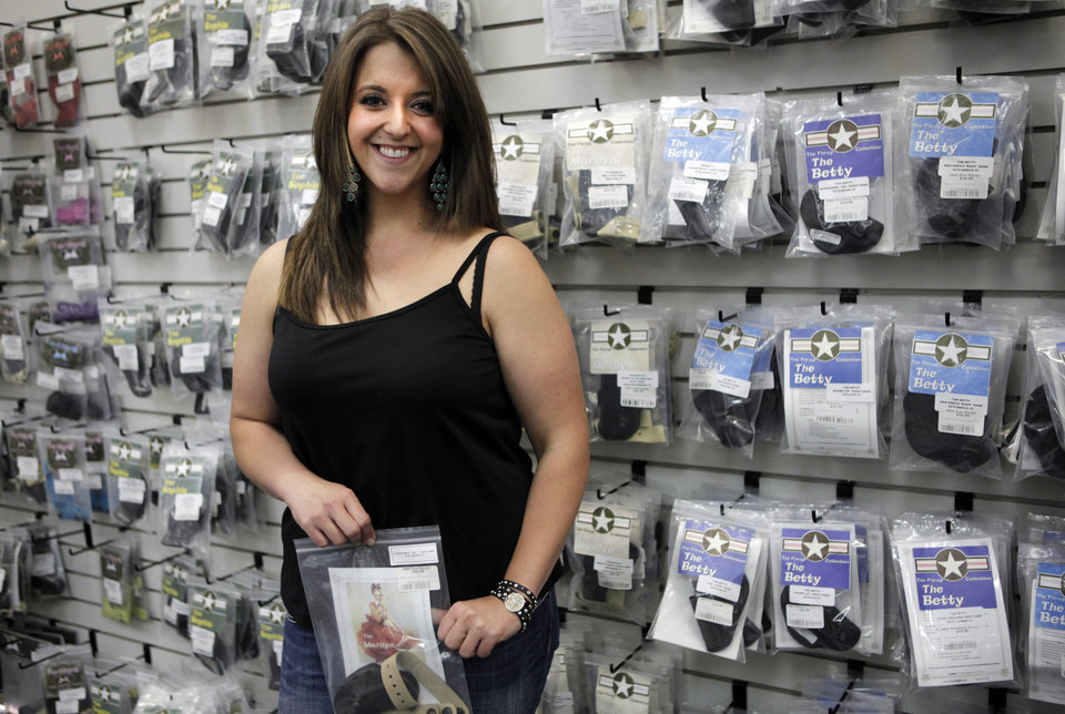 Lisa Looper, owner of Flashbang Holsters poses for a photo at H&H Shooting Sports on Friday. Flashbang Holsters is a subsidiary of Looper Leather and sells holsters designed for use alongside women's clothing. Photo by KT King, The Oklahoman