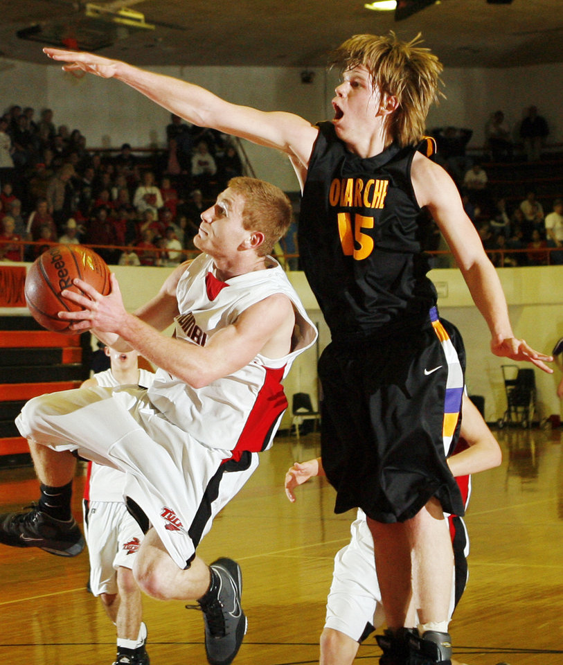 Photo - Okarche's Jabe Karr (15) defends a shot by Aaron Kuns (24) of Turpin during the high school basketball game between Okarche and Turpin in the Class A Boys state basketball tournament at Norman High School in Norman, Okla., Thursday, March 4, 2010. Okarche won, 42-39. Photo by Nate Billings, The Oklahoman