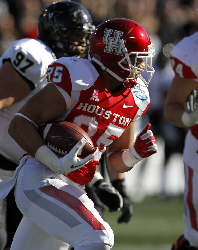 Photo - Houston running back Kenneth Farrow (35) tries to get around the end against Vanderbilt during the first half of the BBVA Compass Bowl NCAA college football game on Saturday, Jan. 4, 2014, in Birmingham, Ala. (AP Photo/Butch Dill)