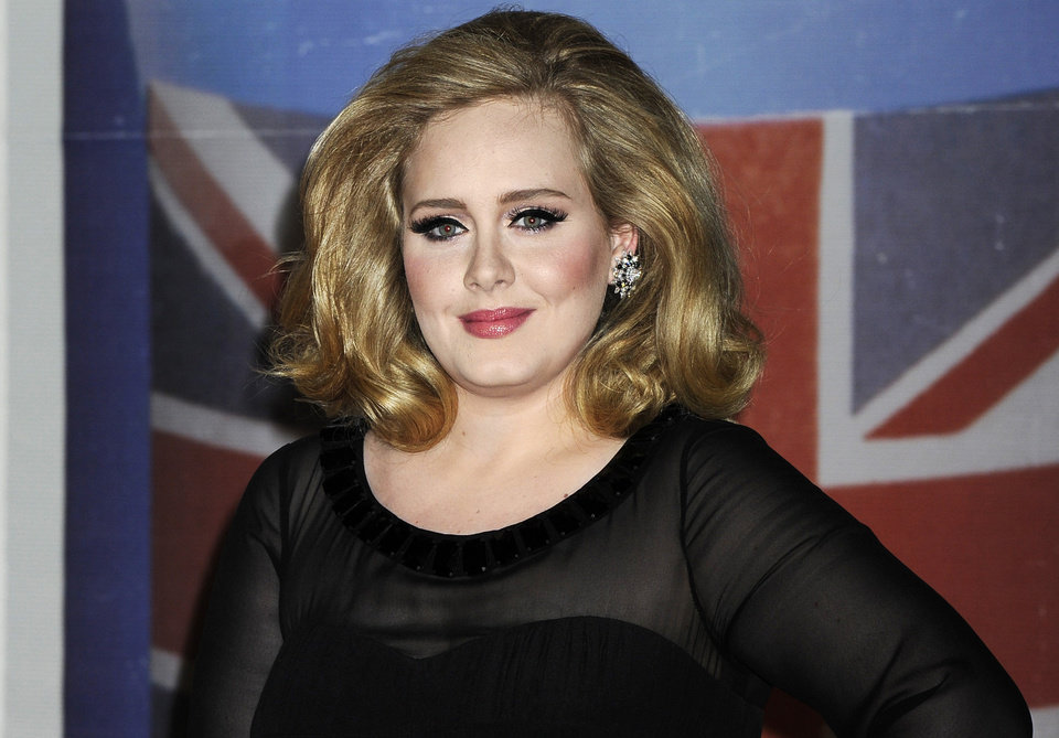 "FILE - In this Feb. 21, 2012 file photo, performer Adele arrives for the Brit Awards 2012 at the O2 Arena in London. The 24-year-old British songstress\' album ""21"" has sold more than 10 million copies, according to Nielsen SoundScan. The album reached the milestone the week of Nov. 19, 2012, less than two years after its release. (AP Photo/Jonathan Short, File)"