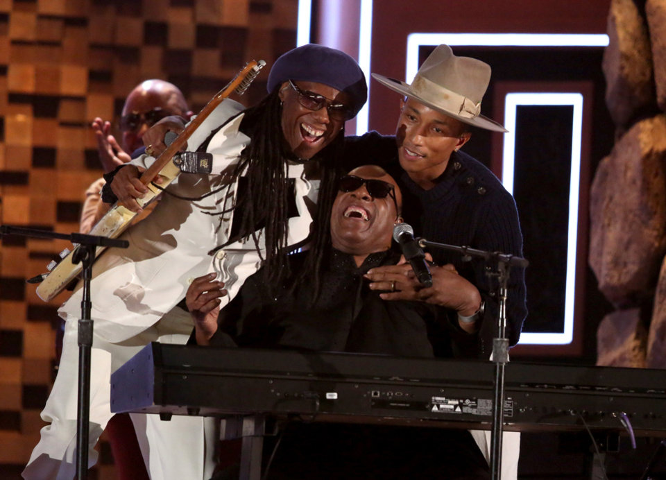 Photo - Nile Rodgers, from left, Stevie Wonder and Pharrell Williams perform at the 56th annual Grammy Awards at Staples Center on Sunday, Jan. 26, 2014, in Los Angeles. (Photo by Matt Sayles/Invision/AP)