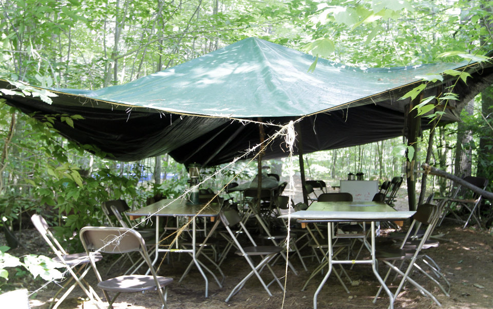 Photo - A covered area with tables and chairs is seen Tuesday June 25, 2013 in Gilmanton, N.H. where the evening  before a group of Boy Scouts seeking protection from a pouring rain storm suffered burns during a campground lightning strike. Twenty three scouts were taken to area hospitals, none with serious injuries. (AP Photo/Jim Cole)