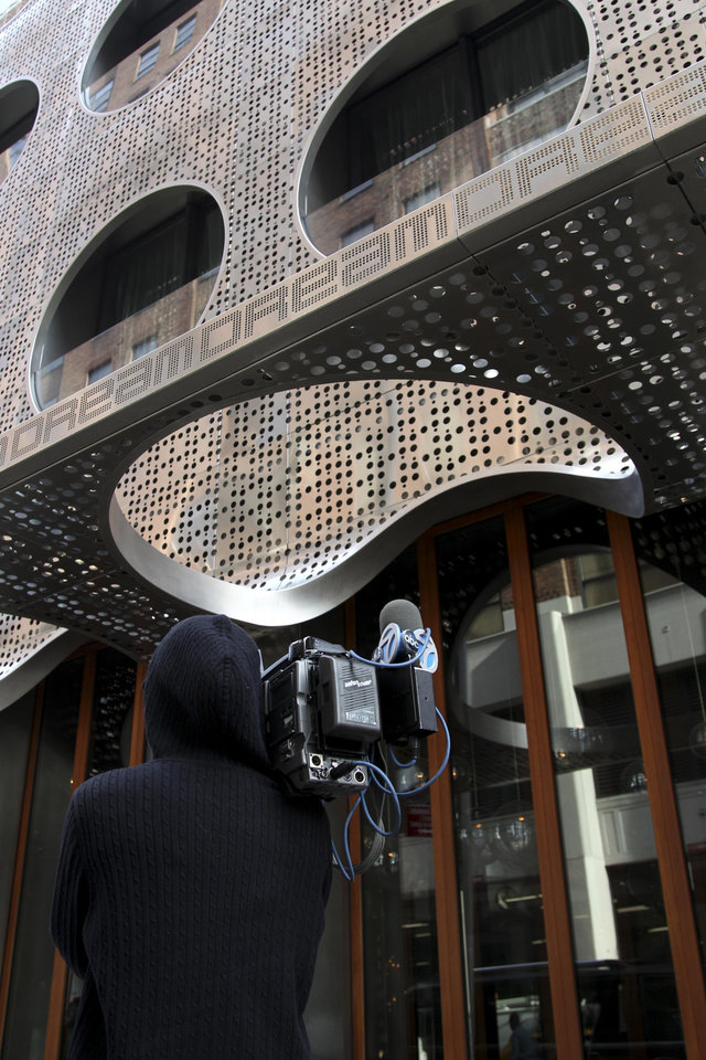 Photo -   A camera man films in front of the Dream Hotel in New York, Wednesday, Sept. 19, 2012. Lindsay Lohan was arrested in New York early Wednesday on charges that she clipped a pedestrian with her car and did not stop, police said. The 26-year-old actress was arrested at 2:25 a.m. as she left a nightclub at the Dream Hotel on 16th Street in Manhattan's Chelsea neighborhood, police said. They said no alcohol was involved. Lohan was charged with leaving the scene of an accident and causing injury. She was given a ticket and will have to appear in court at a later date. (AP Photo/Seth Wenig)