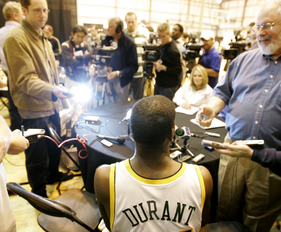 Photo - Seattle SuperSonics' Kevin Durant is in the spotlight as he takes part in the team's annual NBA basketball media day Monday, Oct. 1, 2007, in Seattle. (AP Photo/Ted S. Warren) ORG XMIT: WATW101