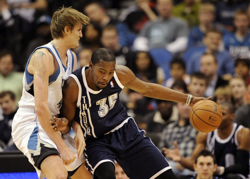 Minnesota Timberwolves\' Andrei Kirilenko, left, of Russia, defends against Oklahoma City Thunder\'s Kevin Durant (35) during the first quarter of an NBA basketball game at the Target Center on Thursday, Dec. 20, 2012, in Minneapolis. (AP Photo/Hannah Foslien) ORG XMIT: MNHF103