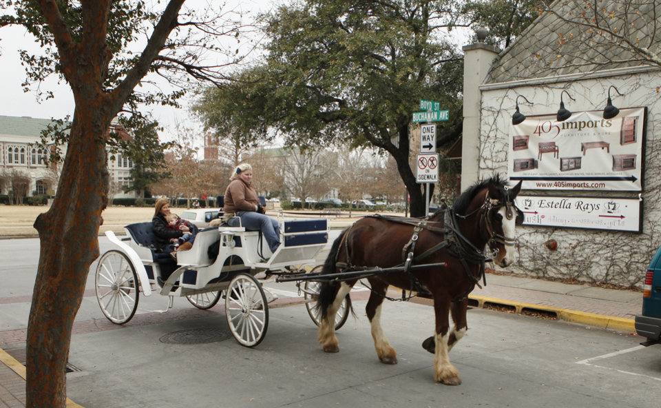 Above: Horse-drawn carriage rides are offered on Campus Corner.  Photo by Steve Sisney, OKLAHOMAN ARCHIVE